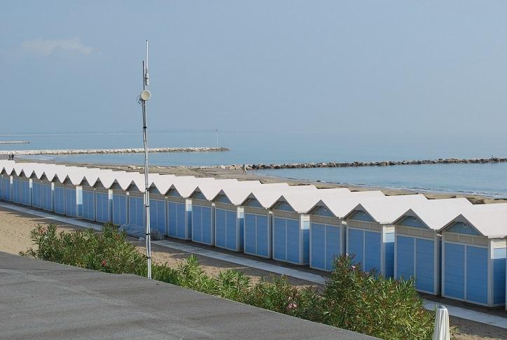 Pláž s prezliekacími búdkami, Lido di Venezia, Benátsko